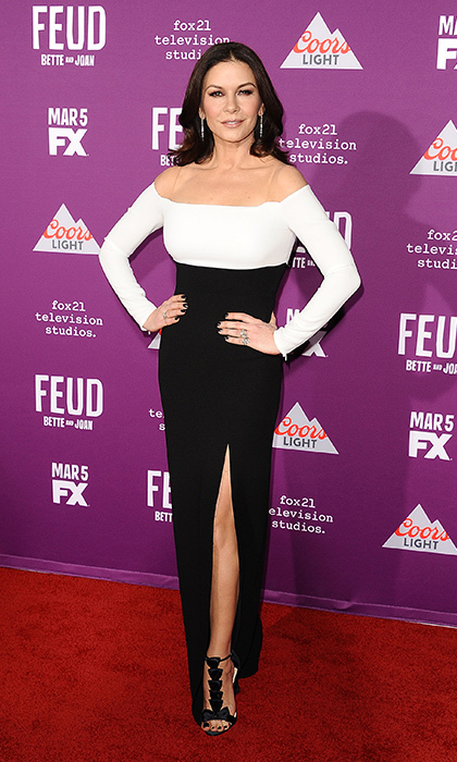 <strong>Mar. 1:</strong> At the premiere of <em>Feud: Bette and Joan</em> in Hollywood, Catherine Zeta-Jones shows off her incredible physique in an off-the-shoulder-gown by Rhea Costa. 