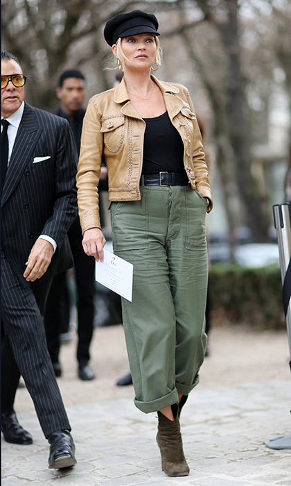 Ultimate style icon Kate Moss rocked a leather jacket and military pants for the Christian Dior presentation. 