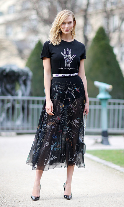 Karlie Kloss combined a silk skirt and graphic tee for the Christian Dior Fall/Winter 2017/2018 show.