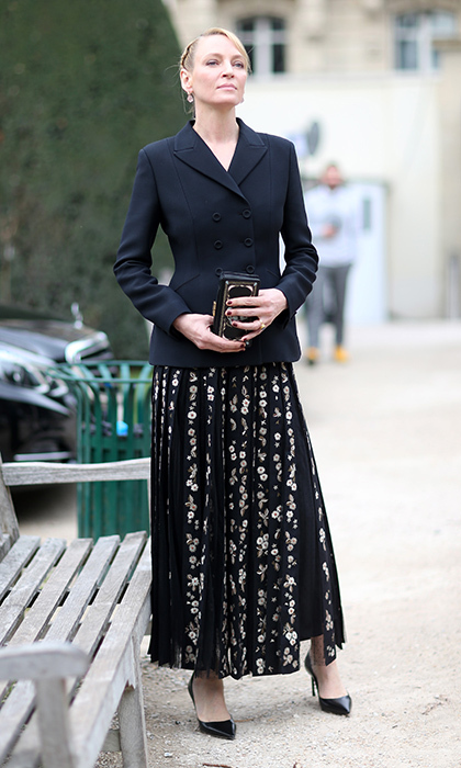 Uma Thurman wore an on-trend midi skirt to Christian Dior. 