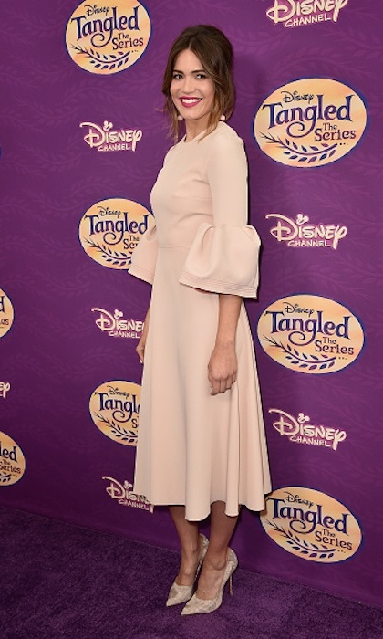 <strong>Mar. 4:</strong> Mandy Moore worked the purple carpet at a screening of <em>Tangled Before Ever After</em> in a fun and flirty dress with dramatic bell sleeves.
