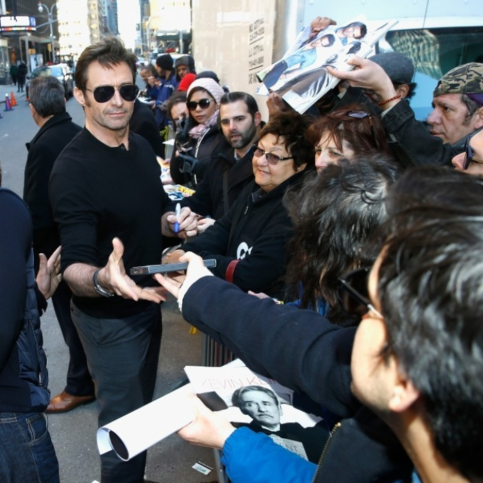 <strong>Mar. 2:</strong> Hugh Jackman kindly stopped to greet his fans outside <em>The Late Show With Stephen Colbert</em> at Ed Sullivan Theater in New York City. The Logan star was out and about to promote his new film.