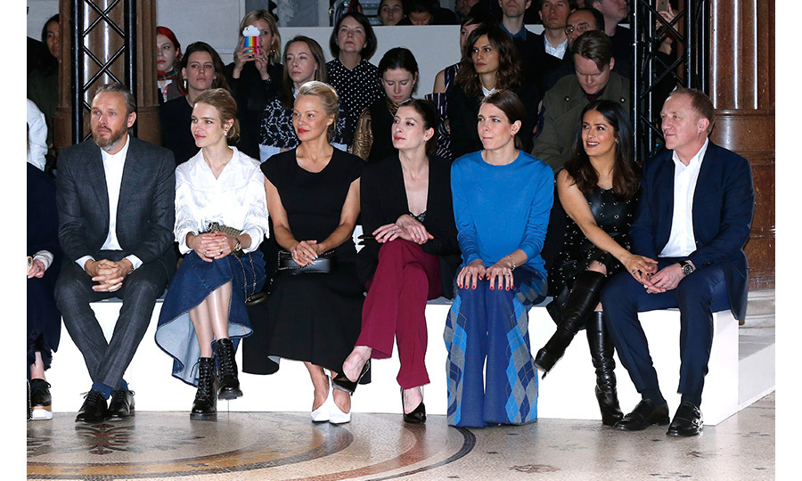 From left to right: Stella McCartney's husband Alasdhair Willis, Natalia Vodianova, Pamela Anderson, Marie-Agnes Gillot, Charlotte Casiraghi, Salma Hayek and her husband Francois-Henri Pinault sat front row at Stella McCartney's presentation. 