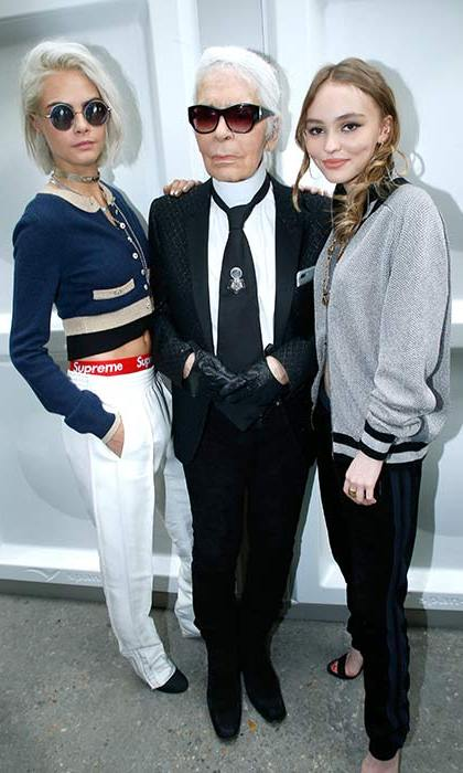 Cara Delevingne caught up with Lily Rose Depp and Karl Lagerfeld at the Chanel show.