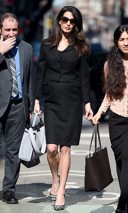 Amal looked effortlessly chic in a black skirt suit as she headed into the United Nations offices in New York. The human rights lawyer elevated her simple separates with eye-catching accessories, including sparkling Salvatore Ferragamo pumps.   