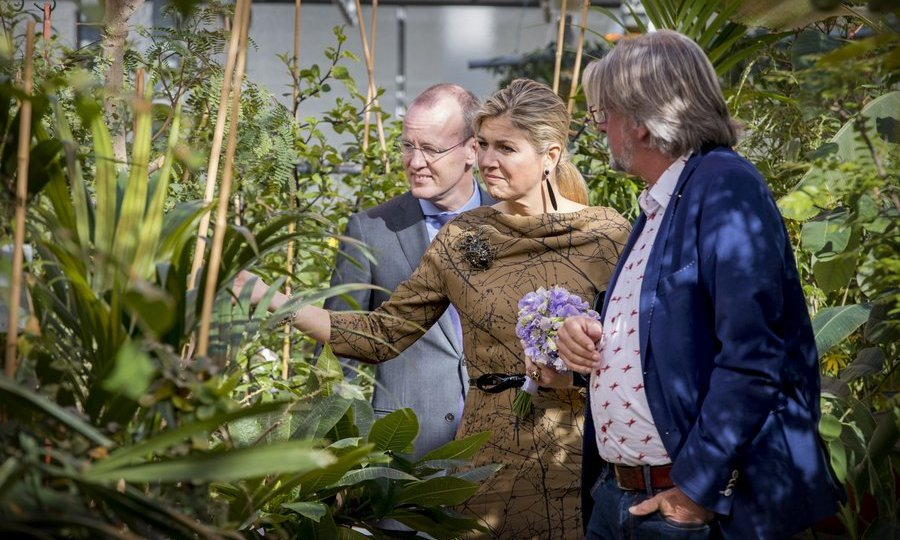 Queen Maxima of the Netherlands put her green thumb to the test as she took a look at shrubbery at the Koppert Cress horticultural company on Mar. 7 in Monster, Netherlands. 