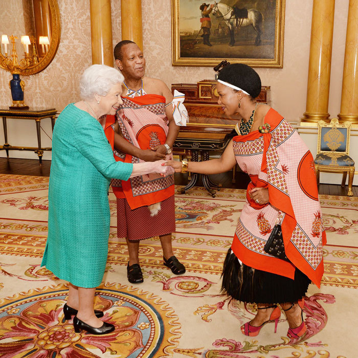 Queen Elizabeth beamed as she greeted the High Commissioner of Swaziland, Christian Muzie Nkambule, and his wife, during a private audience at Buckingham Palace.