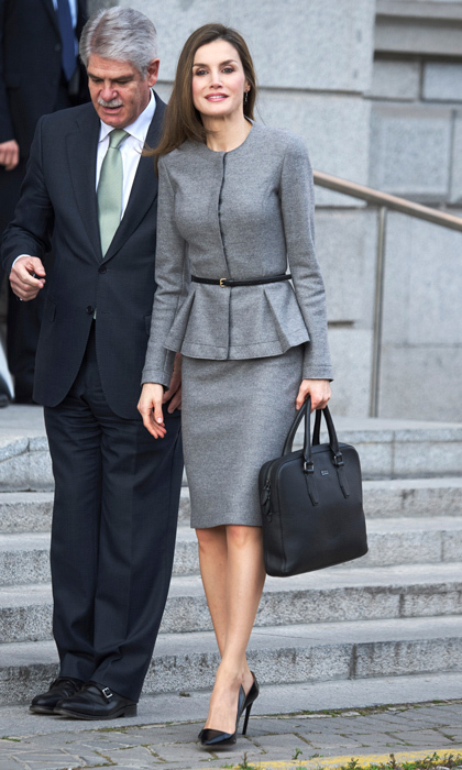 Queen Letizia looked chic wearing a peplum skirt suit to the Spanish Agency for International Development and Cooperation in Madrid, Spain.