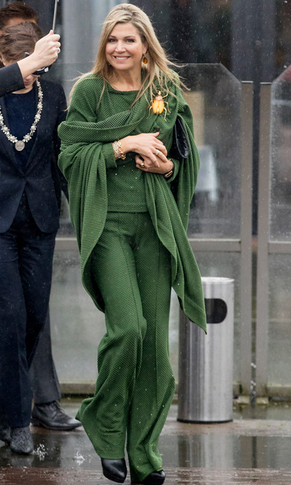 Queen Maxima of the Netherlands made a statement wearing an all-green ensemble, which she accessorized with a beetle brooch to a meeting at Foundation Single Supermom on International Women's Day.