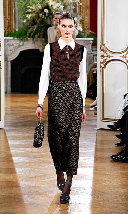 <p><strong>Paris Fashion Week</strong></p><p>For Kate, dressed-down doesn't mean sloppy. This printed pencil skirt, crisp white blouse and tweed sweater vest by Vanessa Seward would best be worn during a relaxing weekend at Sandrigham.</p><p>Photo: © Getty Images</p>