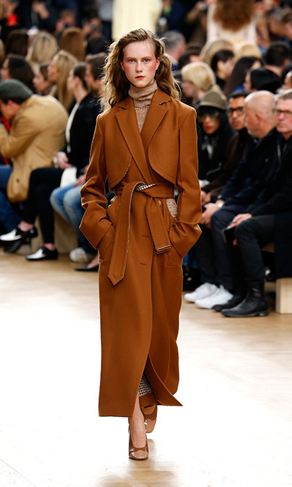 <p><strong>Paris Fashion Week</strong></p><p>Though we know Kate is a fan on the dress-coat, a slightly more relaxed, robe-inspired car coat, like this one by Nina Ricci, would be ideal for weekends spent relaxing outside London.</p><p>Photo: © Getty Images</p>