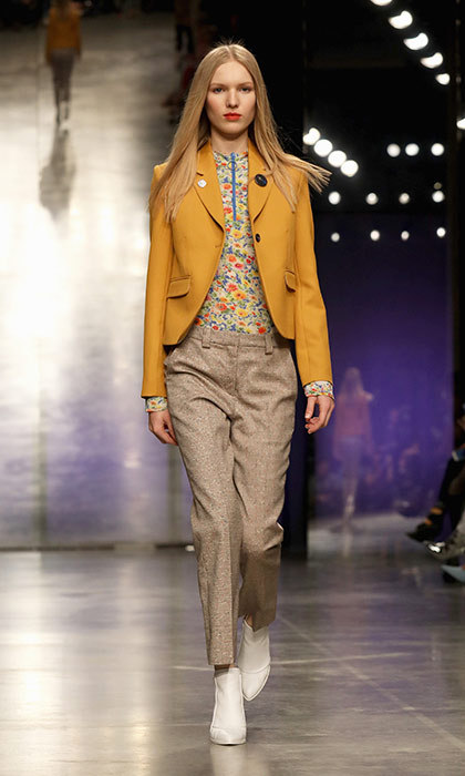 <p><strong>London Fashion Week</strong></p><p>Colour was king on the LFW runways, and this mustard-yellow blazer from Topshop Unique was a standout piece. We love Kate's go-to navy Smythe blazer, but a topper in an unexpected colour would look sharp layered over one of her favourite floral dresses.</p><p>Photo: © Getty Images</p>