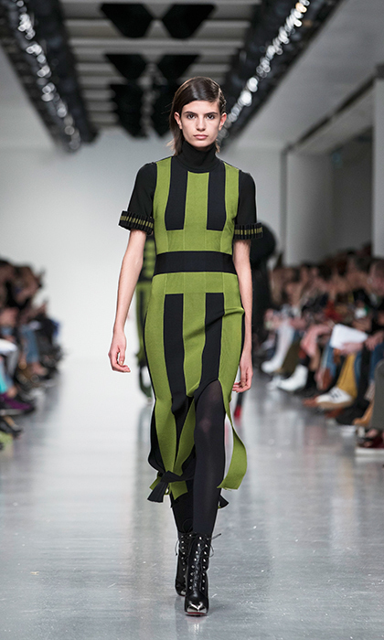 <p><strong>London Fashion Week</strong></p><p>This season, David Koma's collection was featured an there was an abundance of minidresses that always appeal to young starlets. This bright olive green dress, with its clean lines and layered over a black turtleneck, is a little more mature, making it ideal for the Duchess.</p><p>Photo: © Getty Images</p>