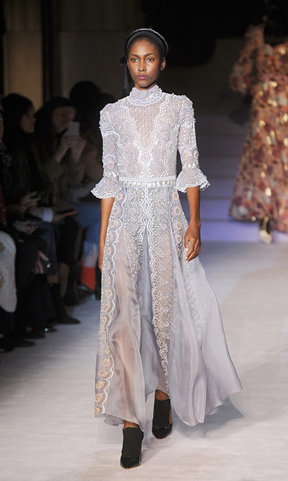 <p><strong>London Fashion Week</strong></p><p>Kate's mother, Carole Middleton, is a long-time fan of Temperely London, and the apple doesn't fall far from the tree. Kate has been spotted in countless frocks from the British brand, and this lace gown is right up her alley. The icy blue colour would look gorgeous with her dark hair, but we expect she'd line it before selecting it for her next royal event, as she's done in the past.</p><p>Photo: © Getty Images</p>