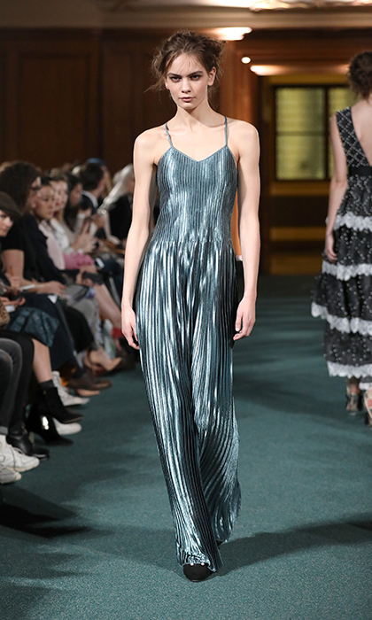 <p><strong>London Fashion Week</strong></p><p>Chinese designer Huishan Zhang's collection was packed with pretty dresses that were definitely Kate-worthy. Although an unexpected silhouette and colour for the Duchess, this shiny pleated number would be perfect paired with a luxe necklace for an evening event.</p><p>Photo: © Getty Images</p>