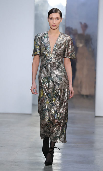 <p><strong>New York Fashion Week</strong></p><p>Having dressed Jackie Kennedy, Hillary Clinton and Michelle Obama, Carolina Herrera is a designer who knows how to showcase the dignified confidence of the world's leading ladies. This shimmering sequin-covered tea gown has a streamlined silhouette that gives it the perfect balance of ease and elegance, making it suitable for anything form a garden party to an art fundraiser.</p><p>Photo: © Getty Images</p>