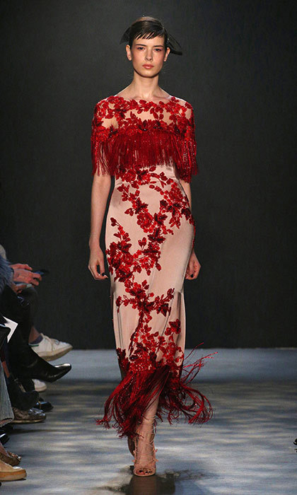 <p><strong>New York Fashion Week</strong></p><p>The Duchess has yet to don one of the high-drama gowns from British-born design duo Georgina Chapman and Keren Craig, and we think this swingy tassle-bedecked dress from Marchesa's fall 2017 runway is her perfect foray into the brand beloved by Hollywood's A-listers. The demure neckline makes it appropriate for any event, but the unexpected fringe details and eye-catching scarlet floral print would be smashing for Kate's next gala or red carpet appearance.</p><p>Photo: © Getty Images</p>