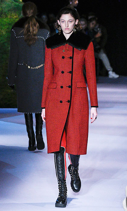 <p><strong>New York Fashion Week</strong></p><p>We can easily picture this double-breasted Altuzarra coat fitting into Kate's collection of enviable outerwear. The mini houndstooth print and oversized square fur collar add a mannish modernity to the tapered feminine silhouette—it's simple enough for everyday outings yet elegant enough for special occasions, especially when dressed up with one of Kate's glimmering brooches and a dramatic fascinator.</p><p>Photo: © Getty Images</p>