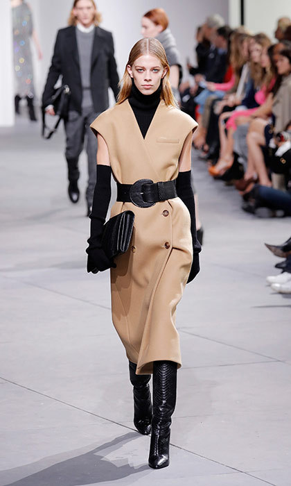 <p><strong>New York Fashion Week</strong></p><p>For his fall 2017 collection, Michael Kors turned out a runway full of beautifully cut workwear separates. This sleeveless, strong-shouldered vest would make a powerful statement for Kate's next charity function—and the tall boots and wide waist-cinching belt would flatter her 5-foot-10 frame. Those elbow-length gloves certainly add an air of royal elegance, don't they?</p><p>Photo: © Getty Images</p>
