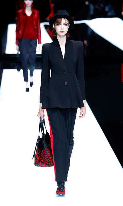 <p><strong>Milan Fashion Week</strong></p><p>Though Kate isn't typically a trouser fan (in fact, she's never worn a pantsuit!), the sleek feminine tailoring and luxurious fabric of this Armani suit would be a welcome addition to the Duchess's wardrobe. Added bonus? It's kid-approved and would make chasing after Charlotte and George a royal synch.</p><p>Photo: © Getty Images</p>