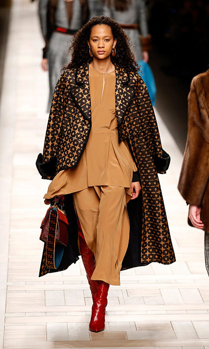 <p><strong>Milan Fashion Week</strong></p><p>As we patiently wait for Kate to embrace culottes, we'll continue to dream up a wardrobe filled with them. And while Fendi's caramel cropped pants and matching top are worthy of a royal turn, it's Karl Lagerfeld's golden-black overcoat that has already surpassed regal status.</p><p>Photo: © Getty Images</p>