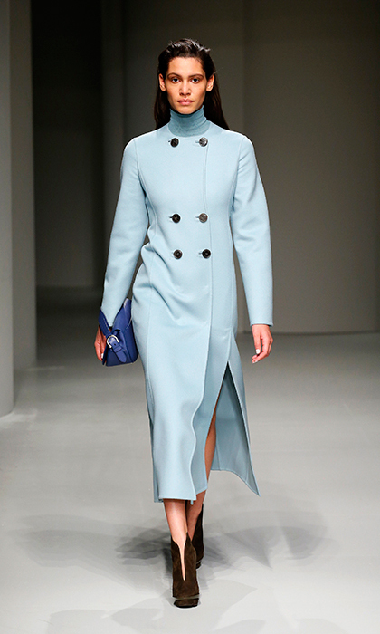 <p><strong>Milan Fashion Week</strong></p><p>This double-breasted powder blue overcoat by Salvatore Ferragamo is waiting to be filed away among Kate's racks and racks of tweed and tartan outerwear. The coat's strategically placed buttons and reserved thigh-high slit add just enough edge to keep it out of dowdy territory.</p><p>Photo: © Getty Images</p>