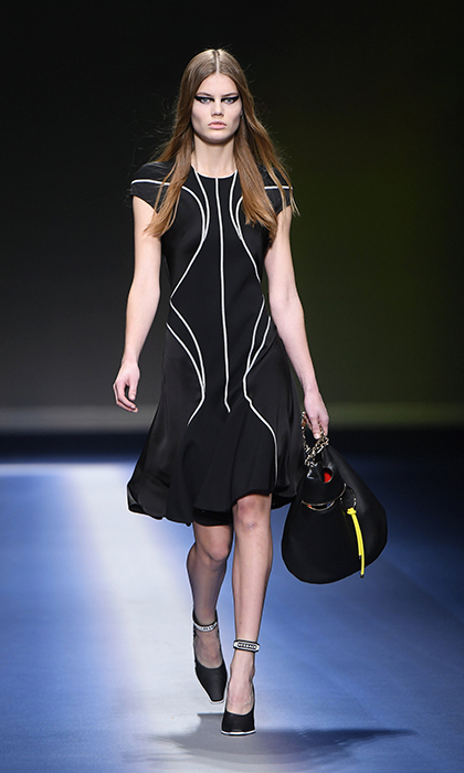 <p><strong>Milan Fashion Week</strong></p><p>Interesting lines and a simple silhouette and palette make this Versace dress a dream for Kate's classic and feminine fashion sense.</p><p>Photo: © Getty Images</p>