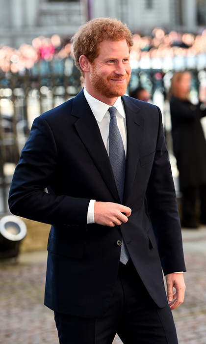 Prince Harry looked dapper in a navy suit as he arrived to the annual Commonwealth Day service and reception in London. 