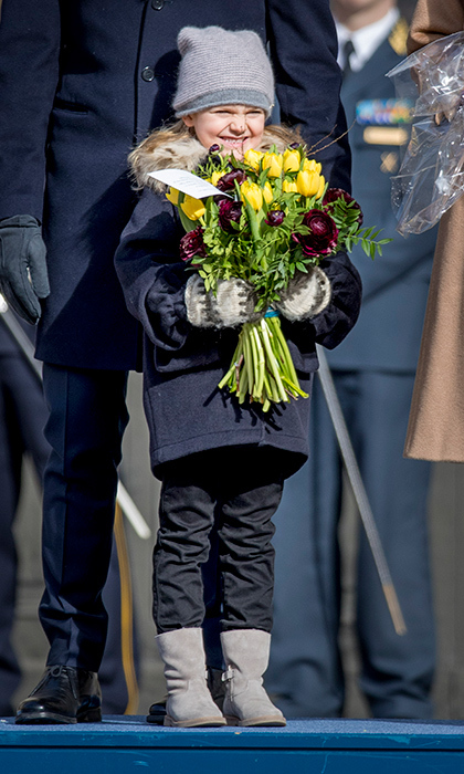 March 2017: Princess Victoria made sure her five-year-old daughter received her own bouquet of flowers during the future queen's name day celebration at the royal palace in Stockholm. Estelle looked delighted with her beautiful bundle of tulips. 