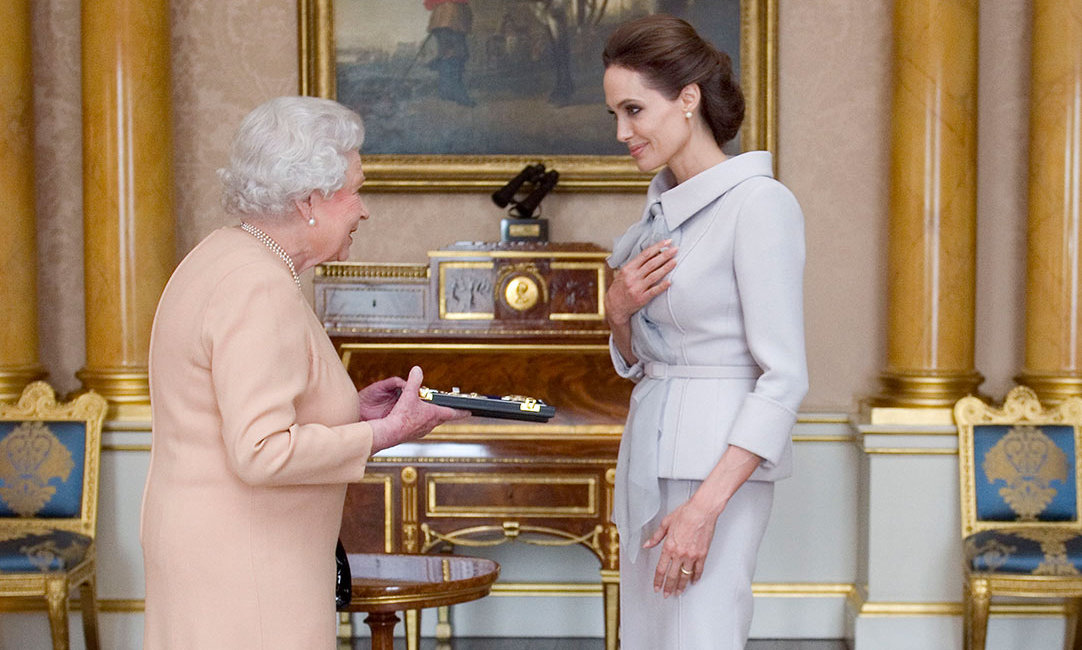 The Queen made Angelina Jolie an honorary dame in 2014.