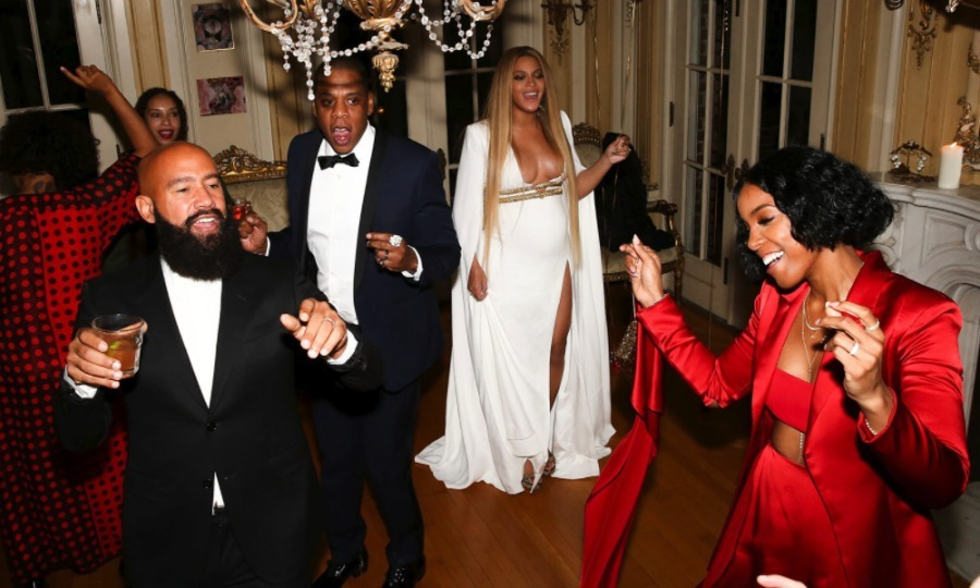 Beyoncé changed clothes for her sister's Grammys after-party opting for a long white gown with gold accents. The Queen of maternity style added a matching white cape and gold shoes to her attire that allowed her to party the night away and show off her bump.