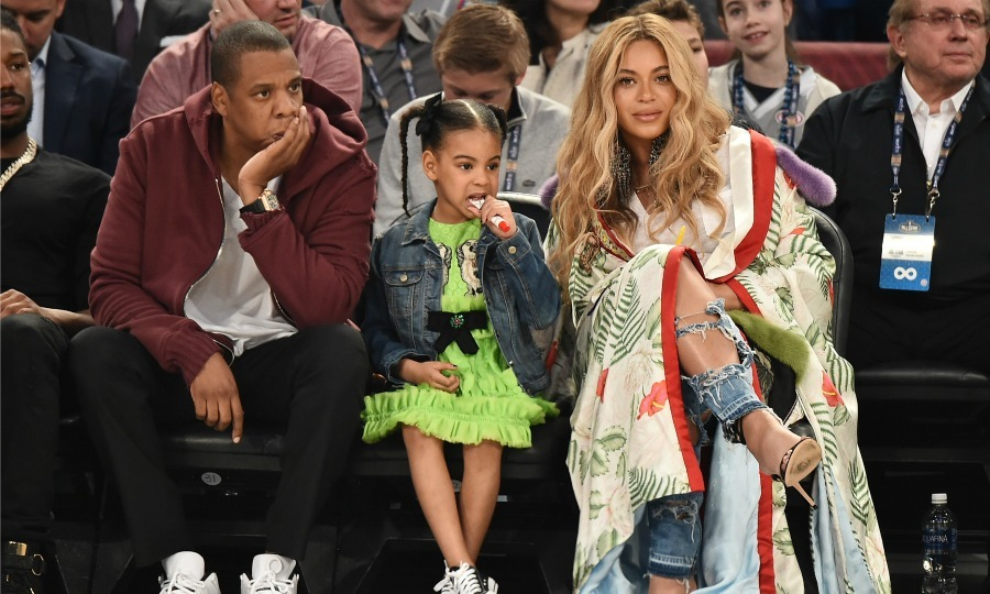 Beyoncé wrapped her bump in a $22,000 Gucci kimono and paired it with distressed denim while she showed off her court side style as she sat next to Jay Z and Blue Ivy during the NBA All-Star game.