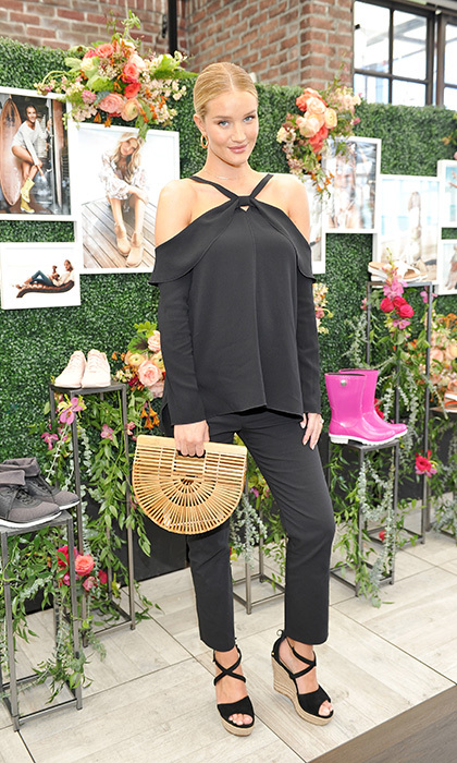 <strong>Mar. 15:</strong> Glowing mom-to-be Rosie Huntington-Whiteley looked super chic in an all-black ensemble at a special luncheon celebrating Rachel Zoe's new collaboration with UGG on Wednesday. 