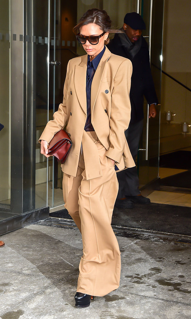 "<a href=""/tags/0/victoria-beckham/"" target=""_blank"">Victoria Beckham</a> exuded both grace and swagger in an oversized beige pantsuit from her Fall/Winter 2017 runway collection and black platform heels while out in New York.  <p>Photo: © Getty Images </p>"