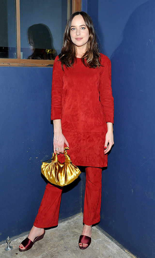 "<a href=""/tags/0/dakota-johnson/"" target=""_blank"">Dakota Johnson</a> made a bold statement in a matching red suede ensemble by The Row, paired with a gold bag and eggplant slipper wedges at the The Hollywood Reporter and Jimmy Choo's Power Stylists dinner in L.A.