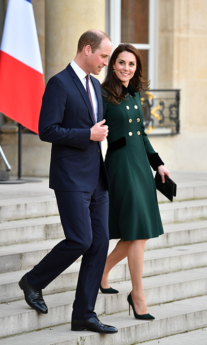 On Friday (Mar. 17), the couple touched down in Paris and headed to their first engagement of the day at the Elysee Palace, with Kate wearing her green Catherine Walker coat from her St. Patrick's Day event earlier that day in London.