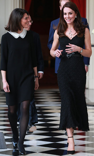 For her first of two formal looks of the night, Kate slipped into a black lace Alexander McQueen frock to attend a reception at the British Embassy.