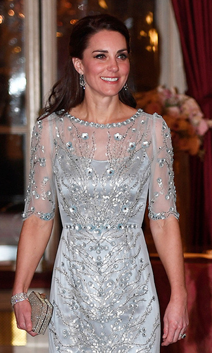 Kate also showed off a pair of diamond chandelier earrings and diamond bracelet, both of which are part of the Queen's extensive jewel collection. 