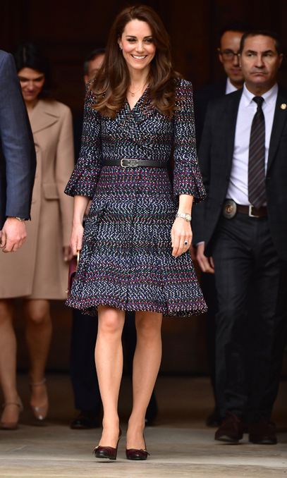 The Duchess of Cambridge embraced French style as she stepped out in a belted double-breasted coatdress by Chanel. The mother of two even mixed up her handbag game by carrying a quilted burgundy clutch from the iconic fashion house. She completed the look with Tod's fringed leather pumps and a Cartier trinity necklace.
