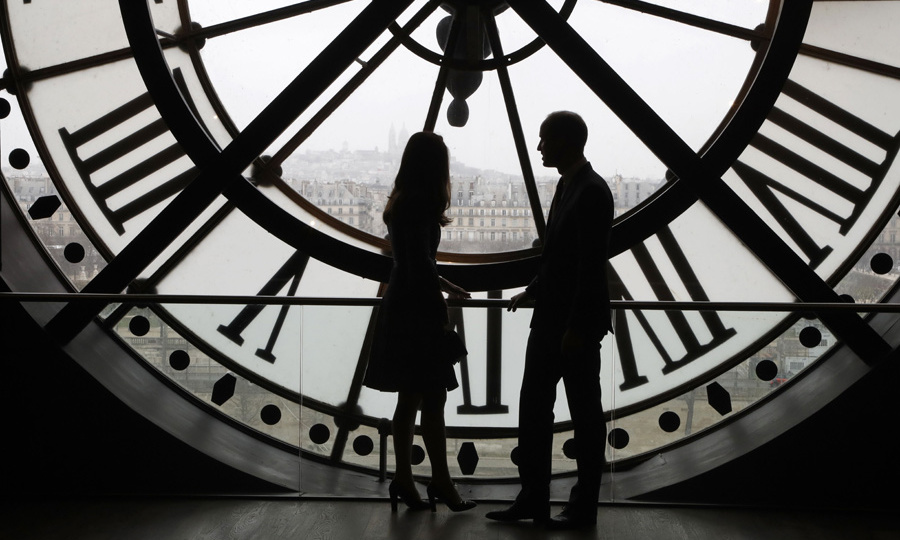 The happy couple and parents of two shared a sweet moment at the Musee d'Orsay, overlooking the most romantic city in the world.