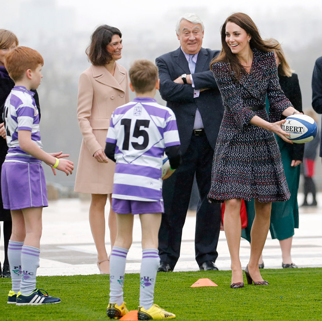 Sporty Kate showed off her skills as she took part in a rugby drill with local children.
