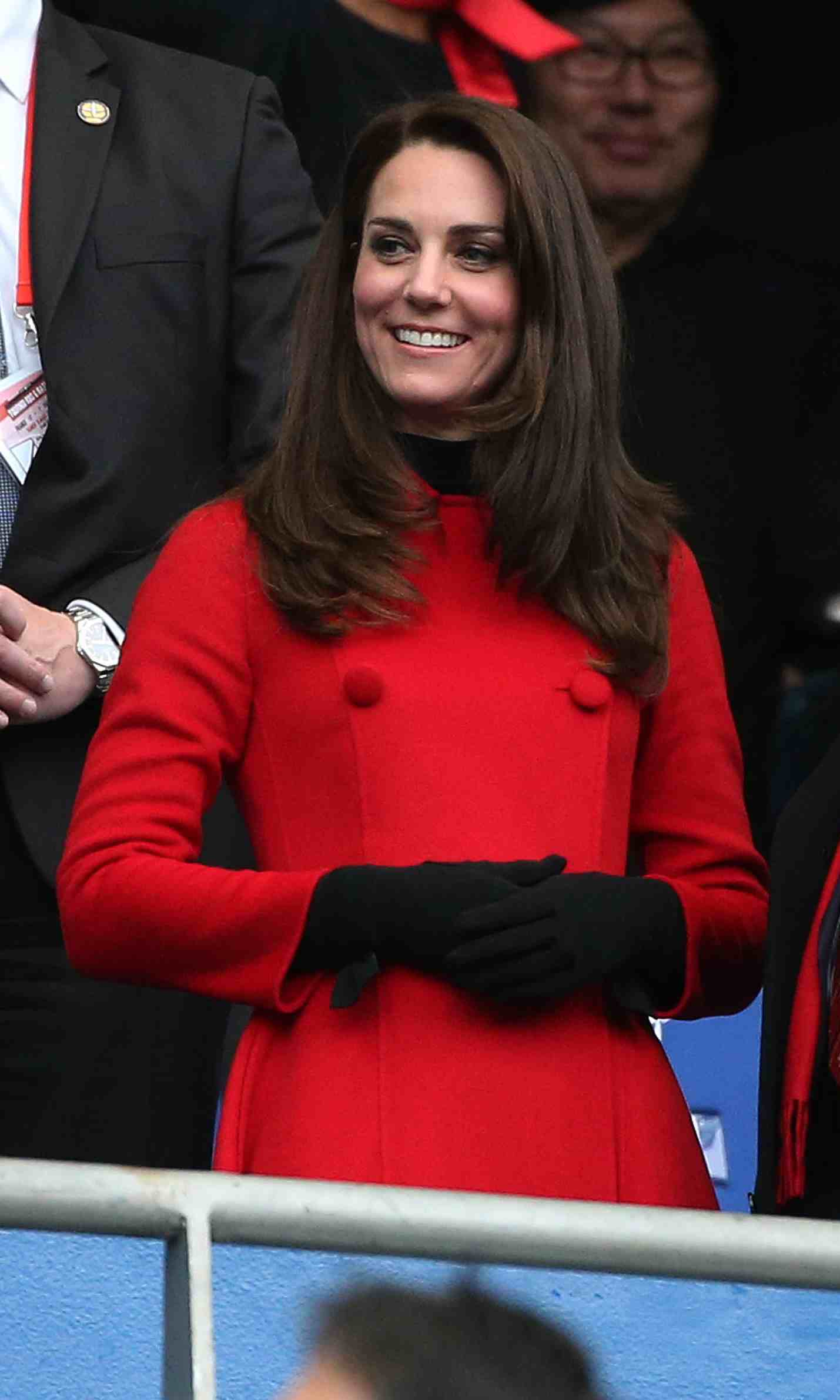 Kate kept warm in a black turtleneck and matching gloves. 