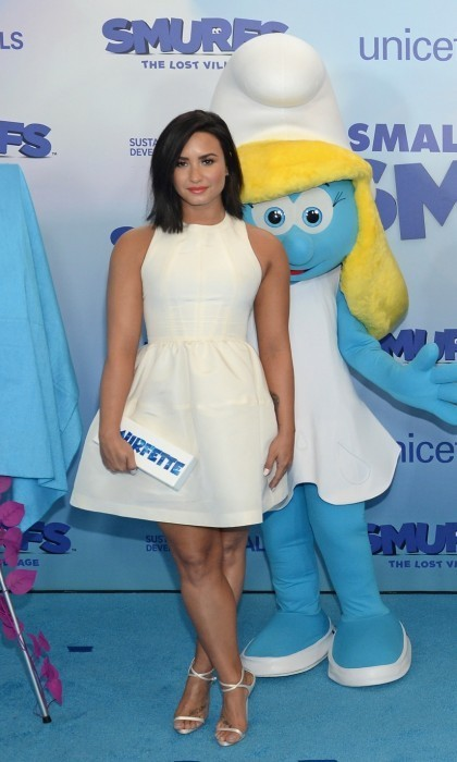 "<strong>March 18:</strong> Demi Lovato looked elegant in white on the blue carpet at the United Nations Headquarters in NYC. The Smurfs: Lost Village star joined her co-stars to celebrate their film and ""International Day of Happiness.""  <p>Demi showed off her toned legs in a Jill Stuart dress and Giuseppe Zanotti heels.