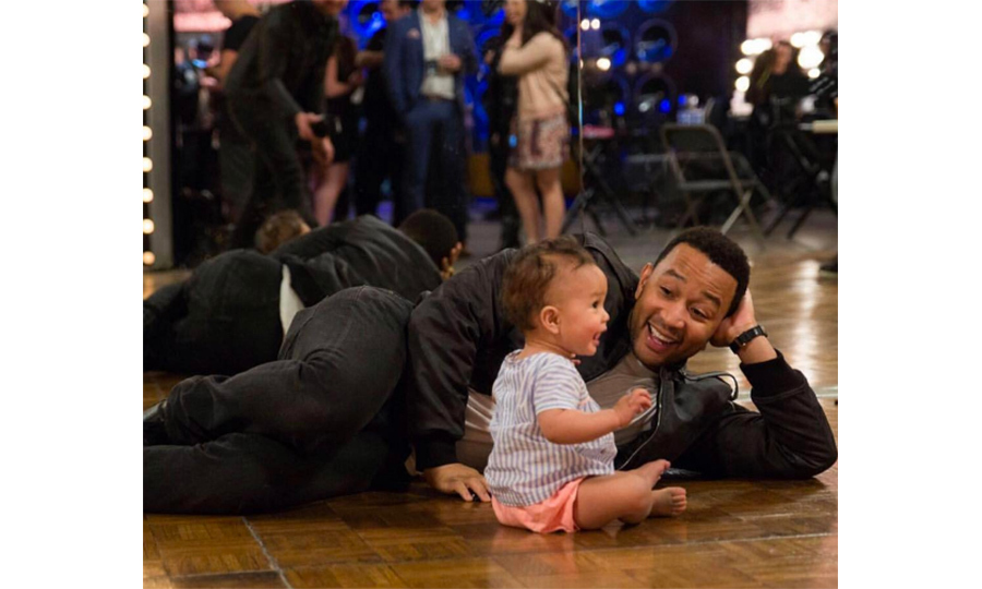Luna shares a laugh with her dad John at a taping of Chrissy's hit show <em>Lip Sync Battle</em>. The youngster will soon add touring to her list of hobbies when she joins her dad on his world tour. 