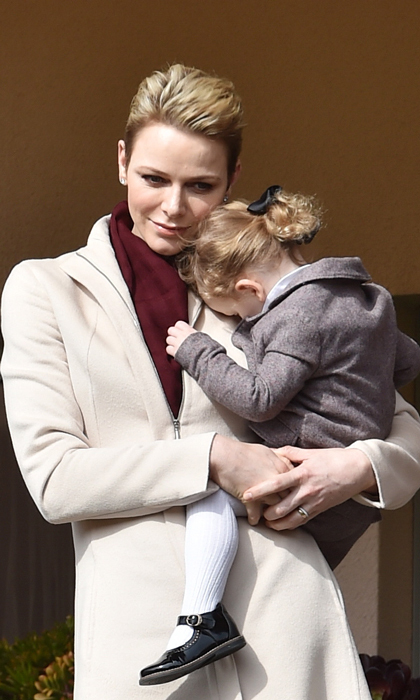 <strong>March 2017:</strong> Princess Charlene gave her young daughter, Princess Gabriella, a cuddle during the Sainte Devote Rugby Tournament in Monte-Carlo.