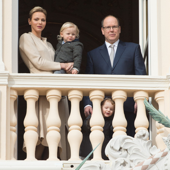 <strong>January 2017:</strong> Princess Gabriella peered through the balcony railings at the Monaco Palace as she attended the ceremony for Sainte-Devote, the patron saint of the Principality of Monaco and Corsica, with her twin brother Prince Jacques and parents.