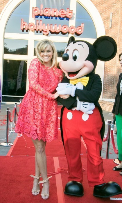 Reese Witherspoon made friends with Mickey Mouse at the opening of Planet Hollywood Disney Springs.