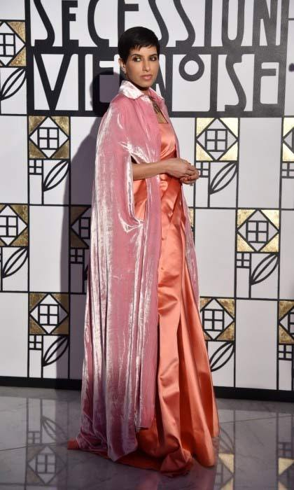 Princess Deena Aljuhani Abdulaziz was also in attendance at the Rose Ball. The Vogue Editor-In-Chief, turned heads in a pink velvet cape and gown.