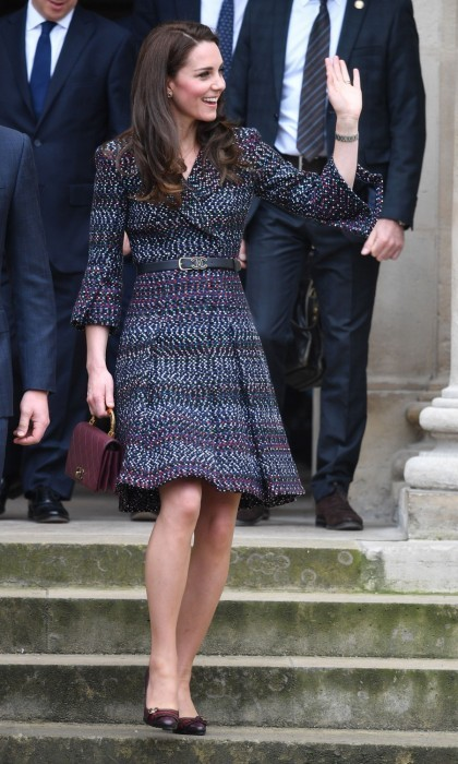 Chic in Chanel! On day two, the Duchess of Cambridge continued the tour in Chanel from head to toe. First seen visiting Les Invalides, a military hospital, all eyes were on Kate as she wore a dotted coatdress, cinched at the waist with a belt, and carried a quilted maroon bag.