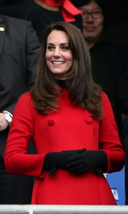 Later on, Kate stood out in the crowd, rockin' a red Carolina Herrera coat. Wearing a black turtleneck sweater underneath and black wool gloves, she looked as classy as ever. As their final Paris engagement, her and William attended the Six Nations tournament Rugby Union match between France and Wales.